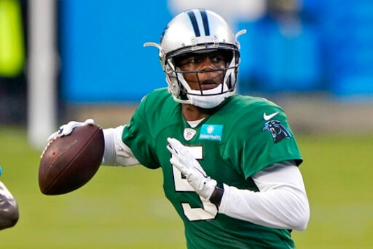 FILE - In this Aug. 26, 2020, file photo, Carolina Panthers quarterback Teddy Bridgewater throws a pass during NFL football practice in Charlotte, N.C. Four years ago the quarterback suffered a torn ACL and fractured kneecap which left his budding NFL career in serious doubt. (AP Photo/Chris Carlson, File)