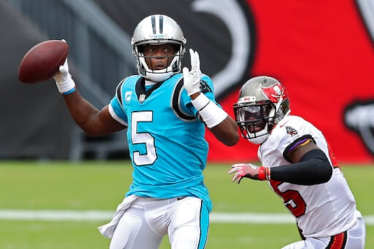 Carolina Panthers quarterback Teddy Bridgewater (5) is pressured by Tampa Bay Buccaneers linebacker Devin White (45) as he throws a pass during the second half of an NFL football game Sunday, Sept. 20, 2020, in Tampa, Fla. (AP Photo/Mark LoMoglio)