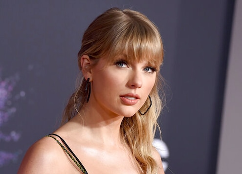 FILE - This Nov. 24, 2019 file photo shows Taylor Swift at the American Music Awards in Los Angeles. A Texas man is sentenced to 30 months in prison after pleading guilty to stalking and sending threatening letters about Swift. A federal judge in Nashville, Tennessee handed down the sentence Wednesday to Eric Swarbrick, who sent over 40 letters and emails to Swift's former record label in 2018, asking the CEO to introduce him to Swift. Over time the letters became more violent and threatening. (Photo by Jordan Strauss/Invision/AP, File)