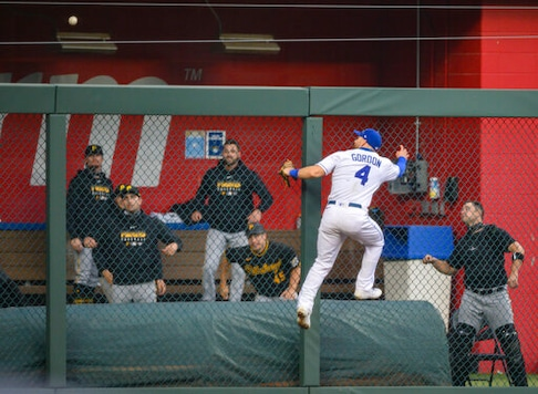 Kansas City Royals left fielder Alex Gordon (4) cannot reach a home run off the bat of Pittsburgh Pirates' Josh Bell during the second inning of a baseball game in Kansas City, Mo., Saturday, Sept. 12, 2020. (AP Photo/Reed Hoffmann)