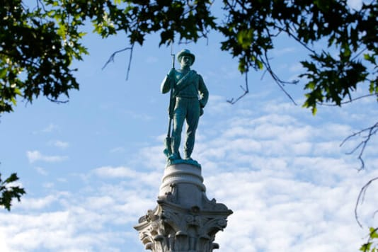 FILE - In this July 8, 2020, file photo, The Confederate Soldiers & Sailors Monument is viewed in Libby Hill Park in Richmond, Va. In a state where Confederate monuments have stood for more than a century and have recently become a flashpoint in the national debate over racial injustice, Virginians remain about evenly divided on whether the statues should stay or go, according to a new poll. The poll conducted this month by Hampton University and The Associated Press-NORC Center for Public Affairs Research found that 46% support removal of Confederate statues and 42% oppose removal. (AP Photo/Steve Helber, File)