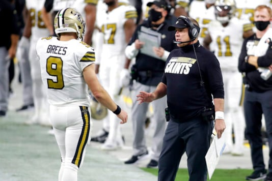 New Orleans Saints head coach Sean Payton speaks with quarterback Drew Brees (9) during the first half of an NFL football game against the Las Vegas Raiders, Monday, Sept. 21, 2020, in Las Vegas. (AP Photo/Isaac Brekken)