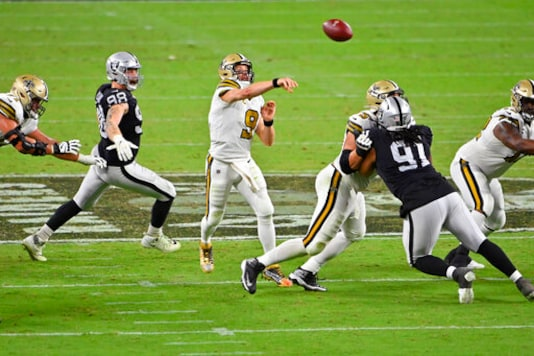 New Orleans Saints quarterback Drew Brees (9) throws against the Las Vegas Raiders during the second half of an NFL football game, Monday, Sept. 21, 2020, in Las Vegas. (AP Photo/David Becker)