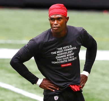 Atlanta Falcons wide receiver Julio Jones wears a shirt in honor of John Lewis while preparing to play the Seattle Seahawks in am NFL football game on Sunday, Sept. 13, 2020, in Atlanta. (Curtis Compton/Atlanta Journal-Constitution via AP)
