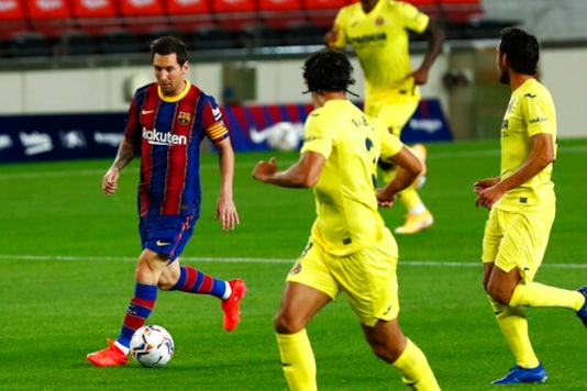 Barcelona's Lionel Messi controls the ball during the Spanish La Liga soccer match between FC Barcelona and Villareal FC at the Camp Nou stadium in Barcelona, Spain, Friday, Sept. 27, 2020. (AP Photo/Joan Monfort)