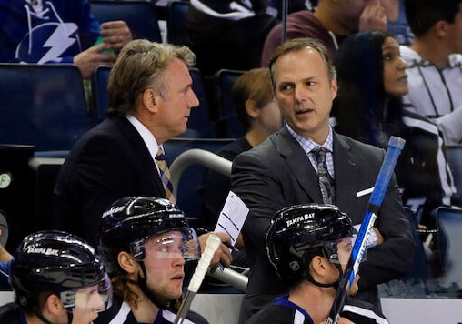 FILE - In this Nov. 21, 2015, file photo, Tampa Bay Lightning head coach Jon Cooper, right, talks to assistant coach Rick Bowness during the first period of an NHL hockey game against the Anaheim Ducks in Tampa, Fla. For the first time in NHL history, a coach is facing a former assistant in the Stanley Cup Final. Dallas Stars interim coach Bowness worked five years as an assistant under Cooper with the Lightning. They parted ways in 2008 and are now facing off in a series of old school vs. new school coaches. (AP Photo/Chris O'Meara, File)