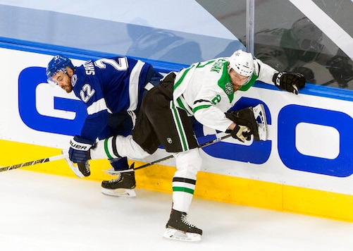 Dallas Stars' Jamie Oleksiak (2) checks Tampa Bay Lightning's Kevin Shattenkirk (22) during first-period NHL Stanley Cup finals hockey action in Edmonton, Alberta, Monday, Sept. 21, 2020. (Jason Franson/The Canadian Press via AP)
