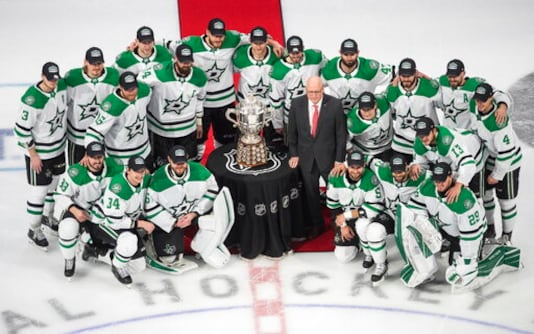 Members of the Dallas Stars pose with the Clarence Campbell Bowl, awarded to the NHL's Western Conference champions, after defeating the Vegas Golden Knights in overtime NHL Western Conference final playoff game action in Edmonton, Alberta, Monday, Sept. 14, 2020. (Jason Franson/The Canadian Press via AP)