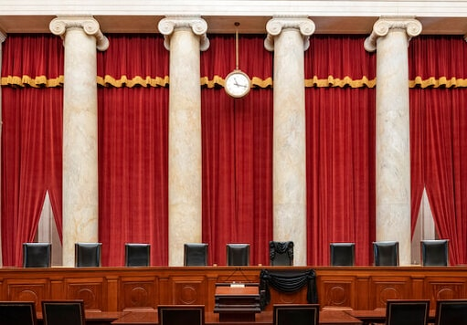This Sept. 19, 2020, photo provided by the Supreme Court, shows the Bench draped for the death of Supreme Court Associate Justice Ruth Bader Ginsburg at the Supreme Court in Washington. (Fred Schilling/Collection of the Supreme Court of the United States via AP)