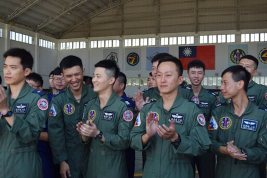 Taiwanese airmen applaud as they listen to Taiwan President Tsai Ing-wen speak during her visit to the Penghu Magong military air base in outlying Penghu Island, Taiwan Tuesday, Sept. 22, 2020. Tsai visited the military base on one of Taiwans outlying islands Tuesday in a display of resolve following a recent show of force by rival China. (AP Photo/Wu Huizhong)