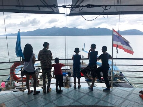 Passengers ride a ferry to the island of Koh Chang seen in the distance, Oct. 20, 2018, in southern Thailand. American expat Wesley Barnes, an English-language teacher in Thailand, was sued for criminal defamation by a hotel at which he stayed on the island because of derogatory reviews he posted online. He could face up to five years in prison on two charges if tried and found guilty. (AP photo/Wally Santana)