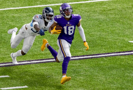 Minnesota Vikings receiver Justin Jefferson (18) runs after a 71-yard touchdown catch during the third quarter of an NFL football game, Sunday, Sept. 27, 2020 in Minneapolis. (Carlos Gonzalez/Star Tribune via AP)