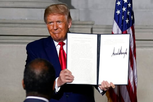 President Donald Trump holds a signed Constitution Day proclamation after he spoke to the White House conference on American History at the National Archives museum, Thursday, Sept. 17, 2020, in Washington. (AP Photo/Alex Brandon)
