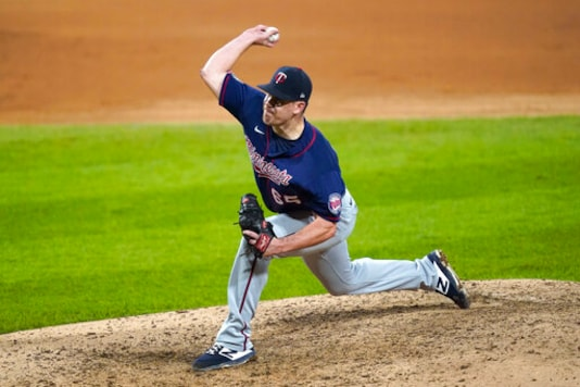 Minnesota Twins relief pitcher Trevor May delivers during the ninth inning of the team's baseball game against the Chicago White Sox on Wednesday, Sept. 16, 2020, in Chicago. The Twins won 5-1. (AP Photo/Charles Rex Arbogast)