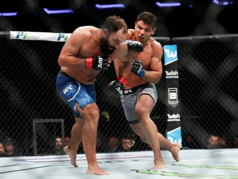 FILE- In this Nov. 4, 2017, file photo, Paulo Costa, of Brazil, punches Johny Hendricks, left, during a middleweight mixed martial arts bout at UFC 217 in New York. Israel Adesanya returns to the UFC cage this weekend to defend his middleweight title against Paulo Costa in the main event of UFC 253.  (AP Photo/Frank Franklin II, File)