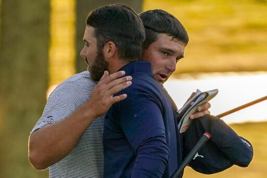 Bryson DeChambeau, of the United States, right, hugs Matthew Wolff, of the United States, after winning the US Open Golf Championship, Sunday, Sept. 20, 2020, in Mamaroneck, N.Y. (AP Photo/John Minchillo)