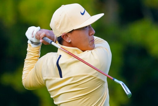 John Pak, of the United States, plays his shot from the third tee during the second round of the US Open Golf Championship, Friday, Sept. 18, 2020, in Mamaroneck, N.Y. (AP Photo/John Minchillo)