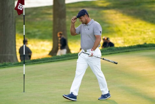 Bryson DeChambeau, of the United States, walks up to the 18th green during the final round of the US Open Golf Championship, Sunday, Sept. 20, 2020, in Mamaroneck, N.Y. (AP Photo/John Minchillo)