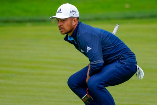 Xander Schauffele, of the United States, checks the break on the 17th green during the second round of the US Open Golf Championship, Friday, Sept. 18, 2020, in Mamaroneck, N.Y. (AP Photo/Charles Krupa)
