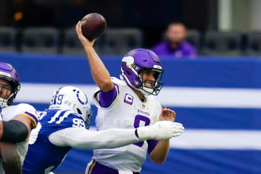 Minnesota Vikings quarterback Kirk Cousins (8) throws while pressured by Indianapolis Colts' DeForest Buckner (99) during the second half of an NFL football game, Sunday, Sept. 20, 2020, in Indianapolis. (AP Photo/Michael Conroy)