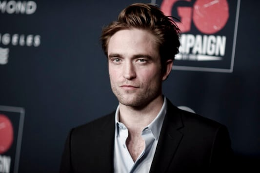 FILE - In this Nov. 16, 2019 file photo, Robert Pattinson attends the 13th Annual Go Gala at NeueHouse Hollywood in Los Angeles.  The U.K. production of The Batman starring Pattinson, is starting up again after being shut down earlier this month when an individual tested positive for COVID-19. A spokesperson for Warner Bros. said Thursday, Sept. 17, 2020,  that filming had resumed after a hiatus for quarantine precautions.  (Photo by Richard Shotwell/Invision/AP)