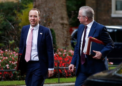Michael Gove Minister for the Cabinet Office and Chancellor of the Duchy of Lancaster, and Matt Hancock Secretary of State for Health and Social Care, left, walk across Downing Street for a cabinet meeting in London, Wednesday, Sept. 30, 2020. (AP Photo/Alastair Grant)