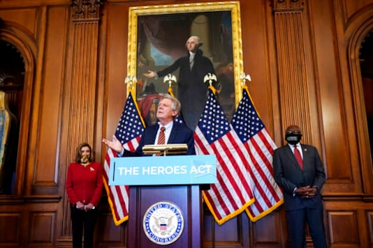 Chairman of the House Energy and Commerce Committee Rep. Frank Pallone, D-N.J., center, speaks next to House Speaker Nancy Pelosi of Calif., left, and House Majority Whip James Clyburn, of S.C., during a news conference about COVID-19, Thursday, Sept. 17, 2020, on Capitol Hill in Washington. (AP Photo/Jacquelyn Martin)