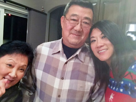 This December 2016 photo provided by the family shows, from left, Lu Wang, Ming Wang and Anne Peterson. Ming Wang, 71, was sickened in March 2020 on a cruise from Australia with his wife, a break after decades of running the familys Chinese restaurant in Papillion, Neb. In the 74 days he was hospitalized, doctors desperately tried various experimental approaches, including enrolling him in a study of an antiviral drug that ultimately showed promise. Ming died on June 8. It was just touch and go. Everything they wanted to try we said yes, do it, said his daughter, Anne Peterson. We would give anything to have him back, but if what we and he went through would help future patients, thats what we want. (Anne Peterson via AP)