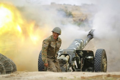 An Armenian serviceman fires a cannon towards Azerbaijan positions in the self-proclaimed Republic of Nagorno-Karabakh, Azerbaijan, Tuesday, Sept. 29, 2020. Armenian and Azerbaijani forces accused each other of attacks on their territory Tuesday, as fighting over the separatist region of Nagorno-Karabakh continued for a third straight day following the reigniting of a decades-old conflict. (AP)