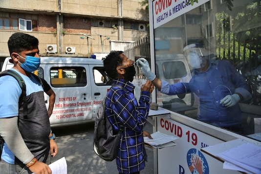 A health worker collects a man's swab sample to test for Covid-19 at a government hospital in Jammu, on October 1, 2020. (AP Photo/Channi Anand)