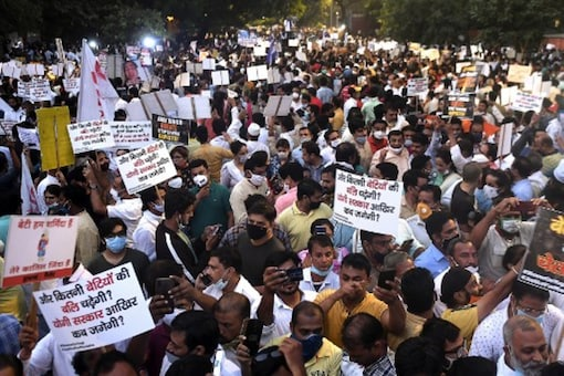 People participate in a protest in New Delhi on Friday. (AFP)