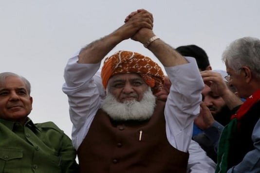 Pakistan's firebrand cleric-cum-politician Maulana Fazlur Rehman has been unanimously appointed as the first president of the Opposition's newly-formed anti-government alliance Pakistan Democratic Movement (PDM), (Image: News18)
