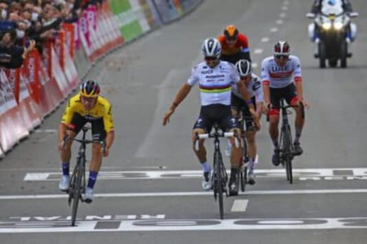 Slovenian Primoz Roglic, left, of the Jumbo - Visma team crosses the finish line to win the Belgian cycling classic and UCI World Tour race Liege Bastogne Liege, in Liege  (Photo Credit: AP)