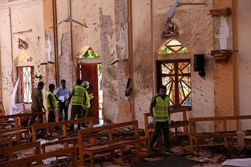 File photo of police officers work at the scene at St. Sebastian Catholic Church, after bomb blasts ripped through churches and luxury hotels on Easter, in Negombo, Sri Lanka on April 22, 2019. (Reuters)