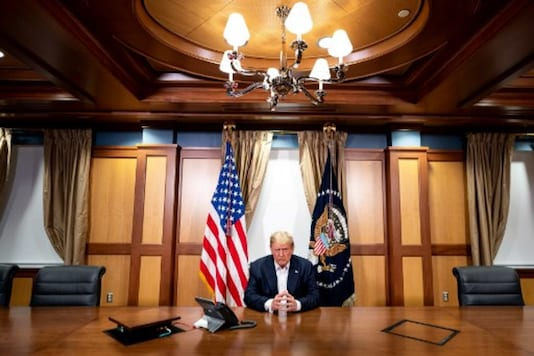 US President Donald Trump and his Chief of Staff (not pictured) participating in a phone call with the US Vice President, Secretary of State and Chairman of the Joint Chiefs of Staff. (AFP File)