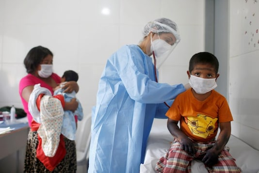 A member of the Brazilian Armed Forces medical team examines a child from the indigenous Guajajara ethnic group, amid the spread of the coronavirus disease (COVID-19), in the indigenous village of Urucu Jurua, municipality of Grajau, Maranhao state, Brazil October 3, 2020. REUTERS/Adriano Machado