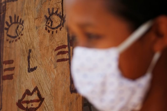 A woman from the Guajajara indigenous ethnic group wears a protective mask, amid the spread of the coronavirus disease (COVID-19), at a community school in the indigenous village of Morro Branco in the municipality of Grajau, state of Maranhao, Brazil October 4, 2020. REUTERS/Adriano Machado - RC2WBJ9PATWR
