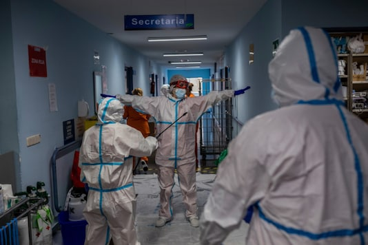 A medical team member is disinfected before leaving the Covid-19 ward at the Severo Ochoa hospital in Leganes, outskirts of Madrid, Spain on October 9, 2020. (AP Photo/Bernat Armangue)