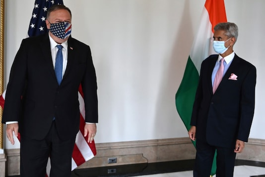 US Secretary of State Mike Pompeo and Indian Foreign Minister S Jaishankar arrive to attend their meeting in Tokyo, on October 6, 2020, ahead of the four Indo-Pacific nations' foreign ministers meeting. (Charly Triballeau/Pool Photo via AP)
