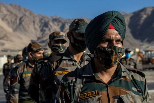 Indian soldiers stand in a formation after disembarking from a military transport plane at a forward airbase in Leh, in the Ladakh region, on September 15, 2020. (REUTERS/Danish Siddiqui)
