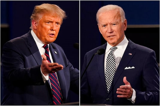 File photo shows President Donald Trump, left, and former Vice President Joe Biden during the first presidential debate at Case Western University and Cleveland Clinic, in Cleveland, Ohio. (AP Photo)