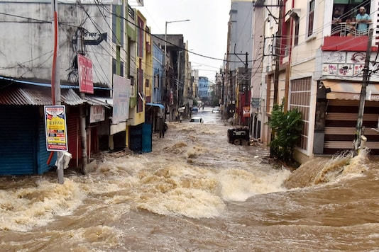 Floodwater gushes through a street following heavy rains, at Falaknuma, in Hyderabad, Wednesday, Oct. 14, 2020. (Image: PTI)