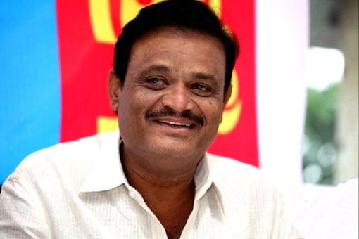 BJP's candidate for RR Nagar constituency Munirathna.