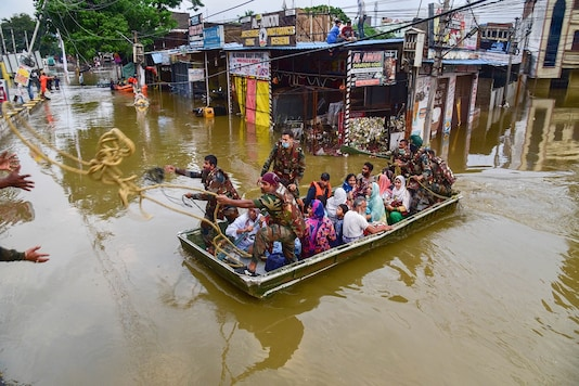 Rescue operation being carried out for locals to move them to safer places following heavy rain, at Al Jubail colony in Hyderabad, on Wednesday. (PTI)