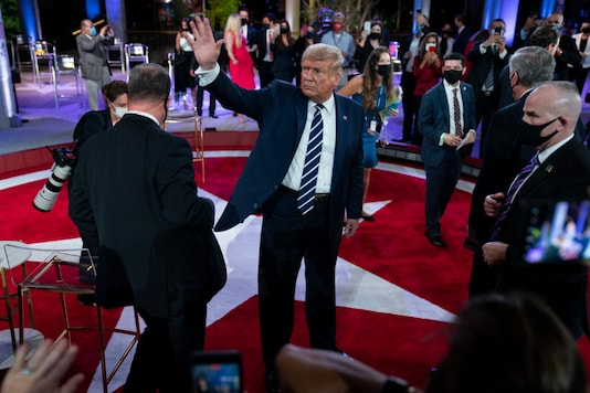 US President Donald Trump waves after participating in an NBC News Town Hall, at Perez Art Museum Miami, on October 15, 2020, in Miami. (AP Photo/Evan Vucci)