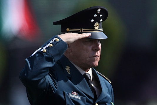 FILE - In this April 16, 2016 file photo, Mexico's Defense Secretary Gen. Salvador Cienfuegos Zepeda salutes soldiers at the Number 1 military camp in Mexico City. (AP Photo/Marco Ugarte, File)