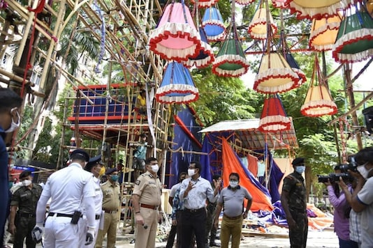 Kolkata Police Commissioner Anuj Sharma takes stock of the arrangements at under-construction Durga Puja pandals.