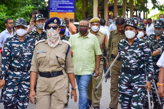 Retired Assam DIG PK Dutta, accused in the police recruitment examination paper leak scam, being produced at a court, in Guwahati, Friday, Oct. 16, 2020. (Image: PTI)