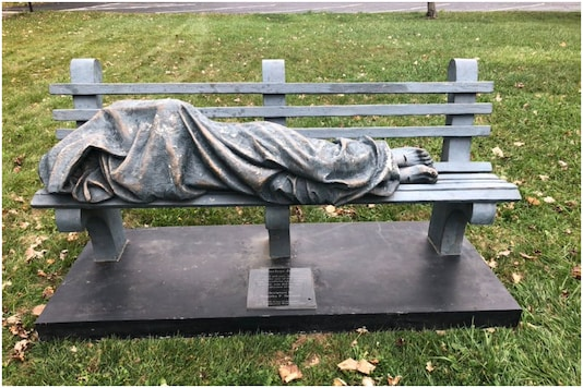 The 'Homeless Jesus' statue was recently installed at a church bench in Ohio, US | Image credit: Twitter