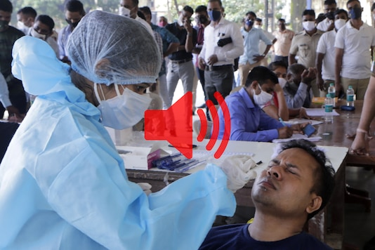 A health worker takes a nasal swab sample at a testing camp for Covid-19 for policemen in Mumbai, on October 15, 2020. (AP Photo/Rajanish Kakade)